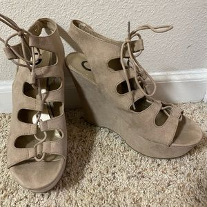 Tan suede wedges by Guess